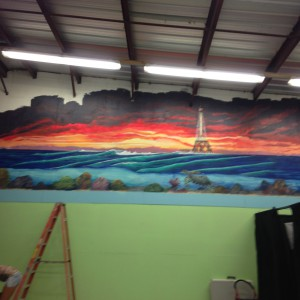 Artist Monique Richter Working on a Mural